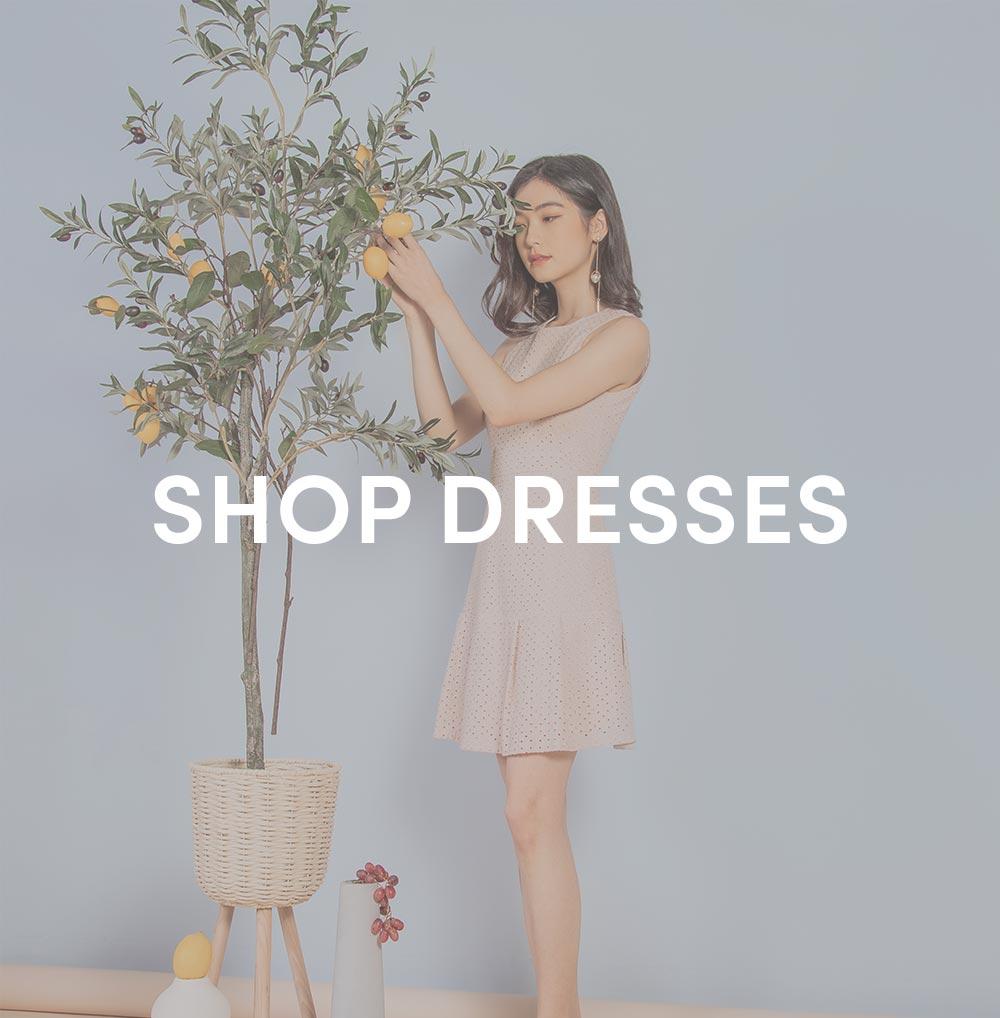 shop dresses at her velvet vase