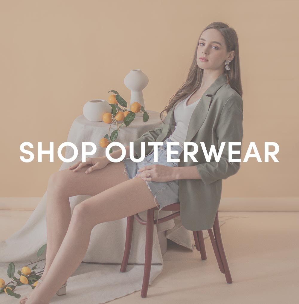 shop outerwear at her velvet vase