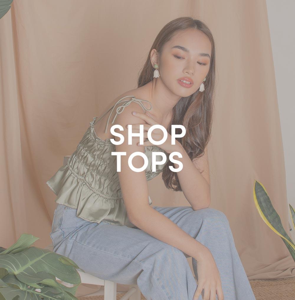 shop tops at her velvet vase